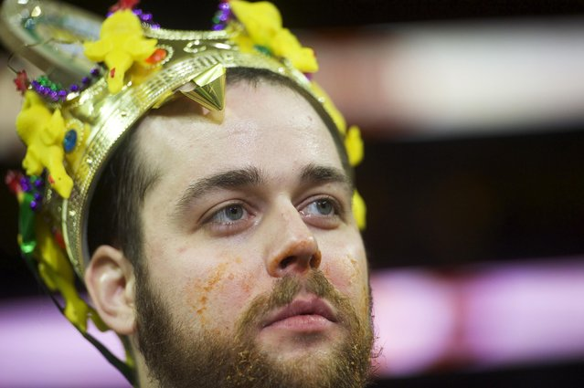 """Patrick """"Deep Dish"""" Bertoletti reacts after winning the 23rd annual Wing Bowl at the Wells Fargo Center in Philadelphia, Pennsylvania January 30, 2015. (Photo by Mark Makela/Reuters)"""