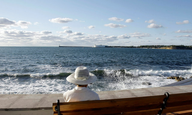 A woman sits at the embankment in the Black Sea city of Sevastopol September 14, 2008. (Photo by Denis Sinyakov/Reuters)