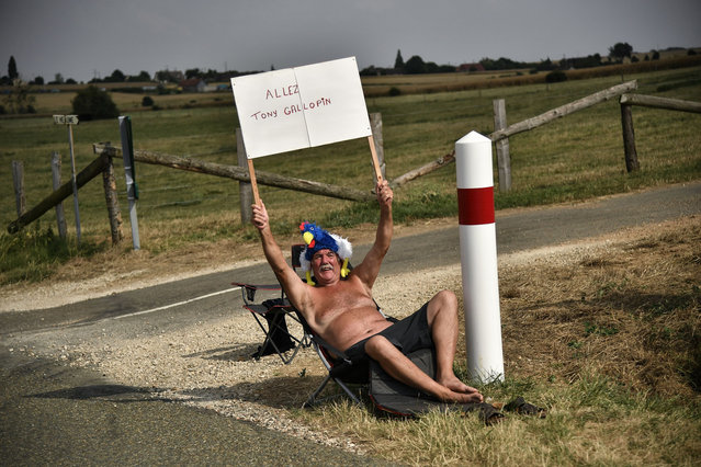 A spectator holds a placard to cheer a rider during the seventh stage of the 105th edition of the Tour de France cycling race between Fougeres and Chartres, western France, on July 13, 2018. (Photo by Marco Bertorello/AFP Photo)