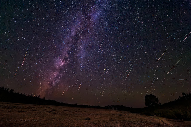 """Photographer Michael Menfee created this composite image – made from 324 shots of 25 seconds each – in August 2012, near Copperton, Wyo. Another image was taken at a longer shutter speed, he writes, for foreground lighting from the moonlight. """"When I saw how clearly the Milky Way was rendering to the west, I couldn't resist pointing one camera away from the meteor shower radiant to test my luck. With over 27 meteors, my luck was very good!"""" he writes. (Photo by Michael Menfee)"""