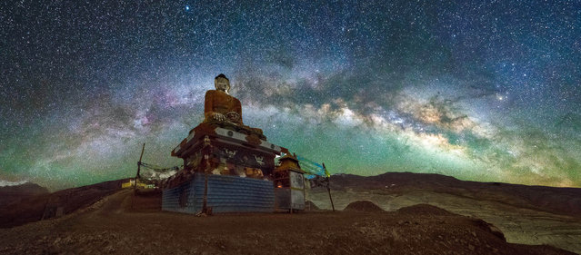 The Milky Way over the Langza Buddha in the Spiti Valley, Himachal Pradesh, northern India. (Photo by Grey Chow/Caters News Agency)