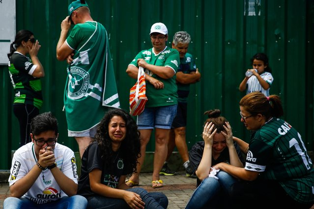 Supporters of the Brazilian soccer team Chapecoense gather at the Arena Conda Arena in Chapeco, Brazil, November 29, 2016, for a vigil in honor of the victims of the plane crash that devastated the team. (Photo by Fernando Bizerra Jr./EPA)