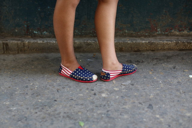 The shoes of a woman who did not give her name are pictured on the street in Havana, July 20, 2015. (Photo by Alexandre Meneghini/Reuters)