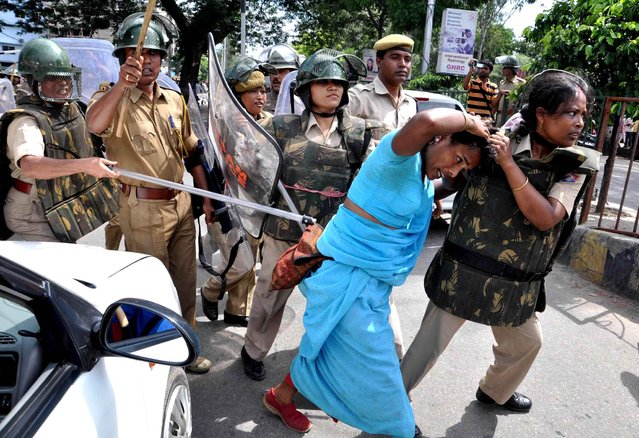 Over 100 activists and supporters of the peasants' organization Krishak Mukti Sangram Samity, along with their president Akhil Gogoi, were detained by police when they infringed into the city's Dispur Last Gate area breaking police barricades to stage Gana Satyagraha outside the capital complex on the eve of Gandhi Jayanti, on October 1, 2013. (Photo AFP Photo/STR)