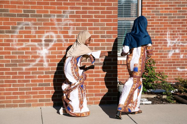 Mahawa and Xiomara Kouyate, originally from Guinea, play outside the Guiding Light Islamic Center during gathering of Eid in Louisville, Kentucky, U.S. May 13, 2021. (Photo by Amira Karaoud/Reuters)