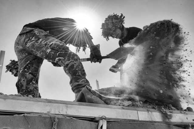 """""""Sun Sand and Soldiers"""" by Jamie, shows Sappers from 21 Engineer Regiment working in the sun to deconstruct a Hesco Bastion building. (Photo by Jamie Peters/PA Wire)"""