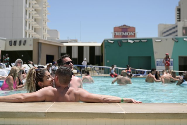Lisa Castello and Wes Bailey relax at the pool at Circa Resort and Casino on Memorial Day in Las Vegas, Nevada, U.S., May 31, 2021. (Photo by Bridget Bennett/Reuters)