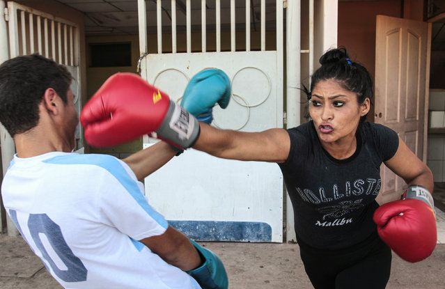 Irene Aguirre, 23, attends a boxing class at the National Institute of Sport in Managua March 4, 2015. (Photo by Oswaldo Rivas/Reuters)