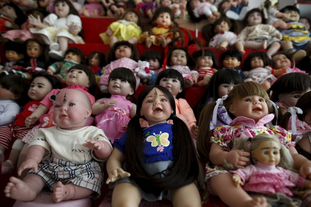 """Child angel"" dolls are pictured at a house that sell the dolls in Nonthaburi, Thailand, January 26, 2016. (Photo by Athit Perawongmetha/Reuters)"