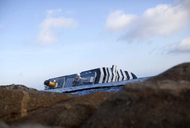 View of the Costa Concordia cruise ship which ran aground off the west coast of Italy at Giglio island, Italy,  January 20, 2012. (Photo by Paul Hanna/Reuters)