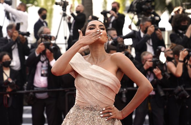 """Indian fashion blogger Diipa Khosla poses for photographers upon arrival at the premiere of the film """"Everything Went Fine"""" at the 74th international film festival, Cannes, southern France, Wednesday, July 7, 2021. (Photo by Brynn Anderson/AP Photo)"""