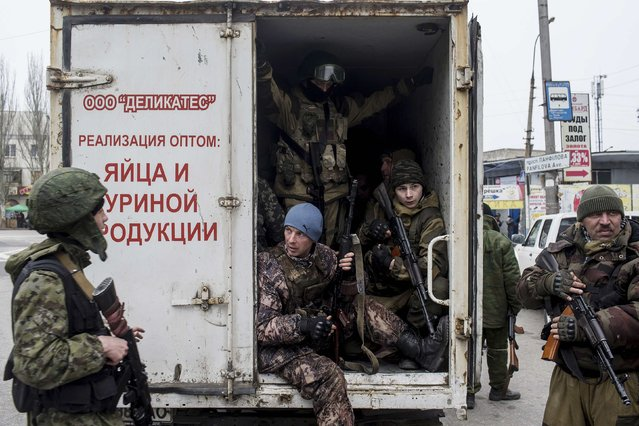 Pro-Russian rebels sit inside a truck, during what the rebels said was an anti-terrorist drill in Donetsk, March 18, 2015. (Photo by Marko Djurica/Reuters)
