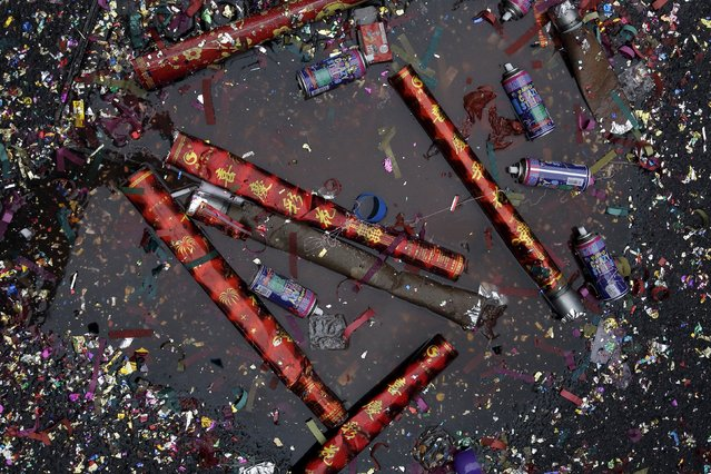 Confetti and spray cans litter the ground as people celebrate the Chinese Lunar New Year in Manhattan's Chinatown in New York February 8, 2016. (Photo by Brendan McDermid/Reuters)