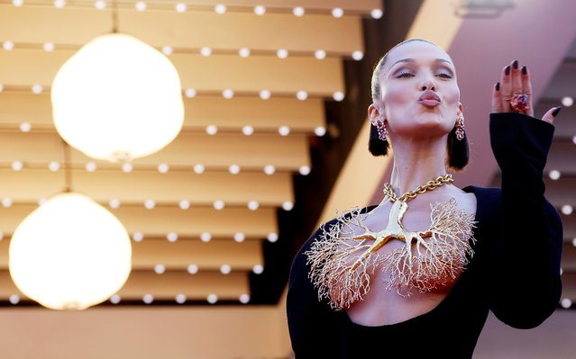 """US model Bella Hadid poses as she arrives for the screening of the film """"Tre Piani"""" (Three Floors) at the 74th edition of the Cannes Film Festival in Cannes, southern France, on July 11, 2021. (Photo by Eric Gaillard/Reuters)"""