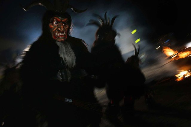 Members of the Haiminger Krampusgruppe parade on the town square during their annual Krampus night in Tyrol in Haiming. (Photo by Sean Gallup)