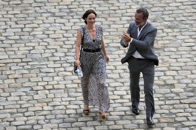 French actor Jean Dujardin and his wife Nathalie Pechalat leave after a tribute ceremony for actor Jean-Paul Belmondo at the Hotel des Invalides, Thursday, September 9 2021 in Paris. France is paying respects Thursday to screen legend Jean-Paul Belmondo with a solemn ceremony led by the president and a public viewing at Napoleon's final resting place. (Photo by Michel Euler/AP Photo)