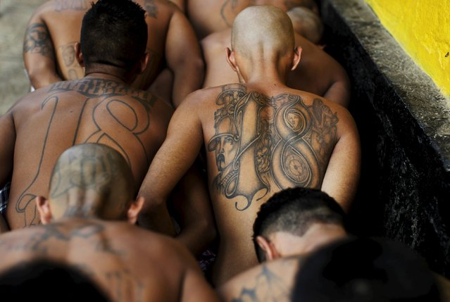 Members of the Barrio 18 gang wait to be admited on their arrival to the San Francisco Gotera penitentiary April 21, 2015. (Photo by Jose Cabezas/Reuters)