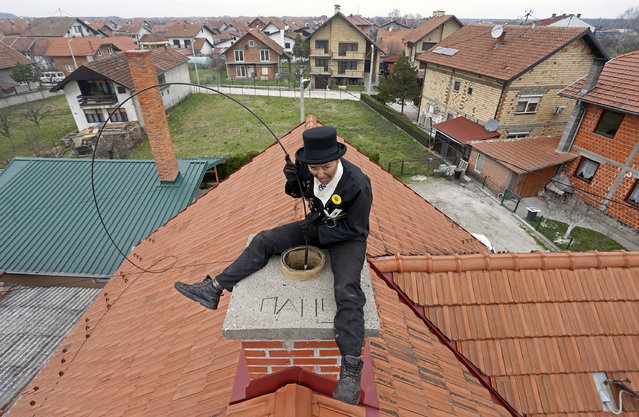 Dajana Djuric, 25, who has worked as a chimney sweep since the age of six, cleans a chimney in Brcko, Bosnia and Herzegovina. Picture taken March 3, 2016. (Photo by Dado Ruvic/Reuters)