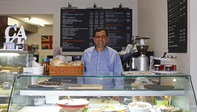"Ayoud Seddiki, 51, poses for a photograph at his workplace, Venezia Coffee, in the London constituency of Brent Central, Britain, April 3, 2015. Seddiki, who was born in Morocco, said: ""The politicians don't deliver everything they promise. They just want to get in power. I used to always vote Labour but I lost interest in politics when they went to war in Iraq for the oil"". (Photo by Eddie Keogh/Reuters)"