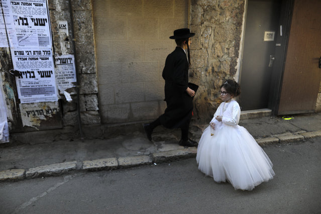 Ultra-Orthodox Jewish children dressed in costumes participate in a school parade celebrating Purim, two days ahead of the official holiday, in the Mea Shearim neighbourhood in Jerusalem on March 19, 2019. The carnival-like Purim holiday is celebrated with parades and costume parties to commemorate the deliverance of the Jewish people from a plot to exterminate them in the ancient Persian empire 2,500 years ago, as recorded in the Biblical Book of Esther. (Photo by Menahem Kahana/AFP Photo)