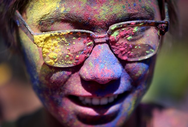 As part of Spring Jam students, international student Tavion Tran from Vietnam, and others got colorful with dyed corn starch at Holi fest along the Mississippi River Saturday, April 25, 2015, at the University of Minnesota campus in Minneapolis, MN. Holi is a Hindu spring festival also known as the festival of colors. (Photo by David Joles/Star Tribune)