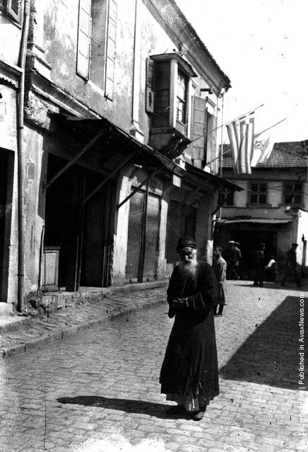 circa 1917:  A bearded Jewish man stands in a cobbled street in Palestine