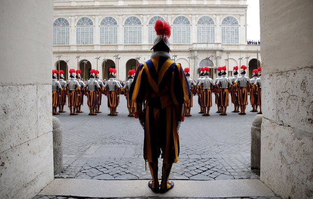 New recruits of the Vatican's elite Swiss Guard stand at attention during the swearing-in ceremony at the Vatican May 6, 2015. (Photo by Giampiero Sposito/Reuters)