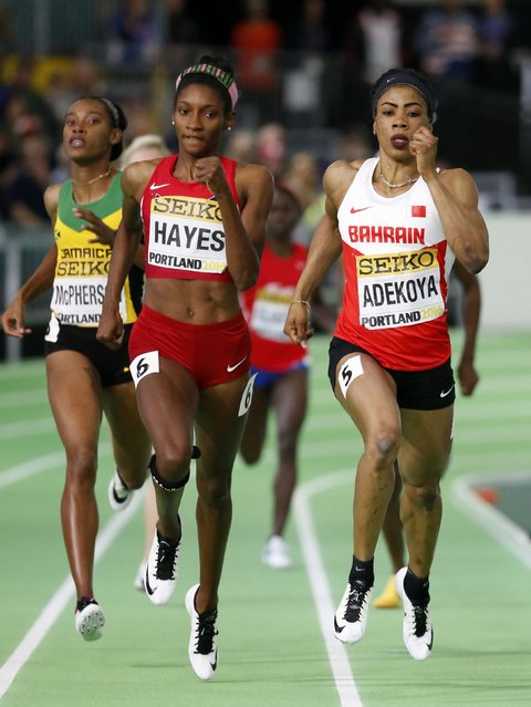 Oluwakemi Adekoya of Bahrain (R) runs ahead of Quanera Hayes of the U.S. in the women's 400 meter semi finals during the IAAF World Indoor Athletics Championships in Portland, Oregon, March 18, 2016. (Photo by Lucy Nicholson/Reuters)