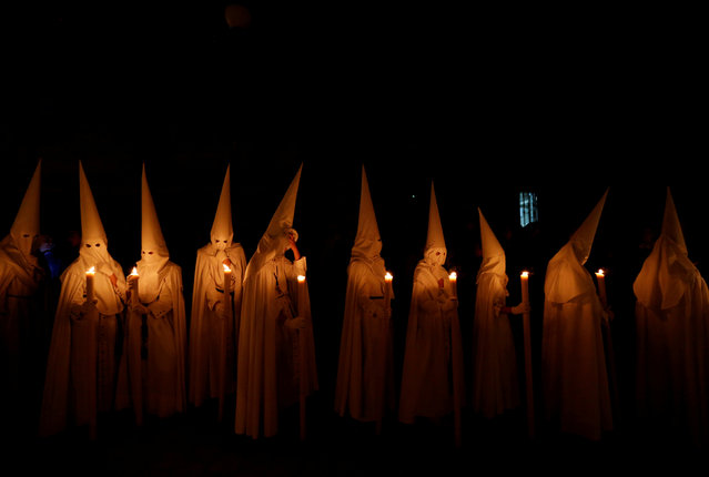 Penitents of La Paz (The Peace) brotherhood take part in a procession during Holy Week in the Andalusian capital of Seville, Spain on April 14, 2019. (Photo by Marcelo del Pozo/Reuters)