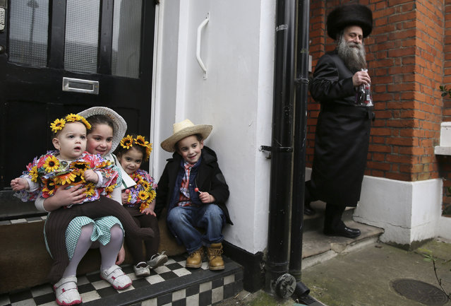 A Jewish family dressed in colourful costumes celebrate the festival of Purim in Stamford Hill in north London, Britain March 24, 2016. (Photo by Neil Hall/Reuters)