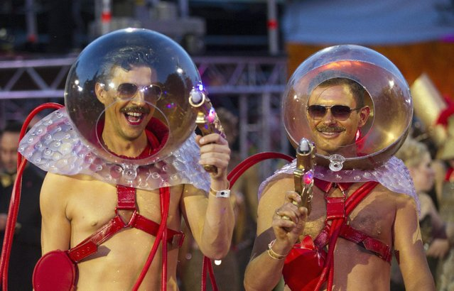 Costumed guests pose for photographers during the opening ceremony of the Life Ball in front of City Hall in Vienna, Austria, Saturday, May 16, 2015. The Life Ball is a charity gala to raise money for people living with HIV and AIDS. (Photo by Herwig Prammer/AP Photo)