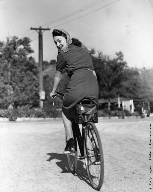 1938: Hollywood screen star Olivia De Havilland riding a bicycle
