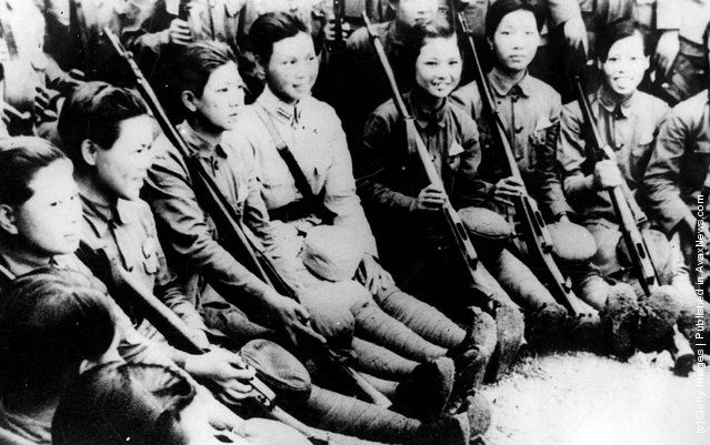 1944: Chinese girls receiving tuition in the use of rifles at their barracks. Over 20,000 girls have so far been trained for service with the Chinese army