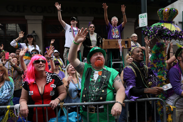 People cheer at floats as they pass by during the Krewe of Zulu parade during Mardi Gras in New Orleans, Louisiana U.S., February 28, 2017. (Photo by Shannon Stapleton/Reuters)