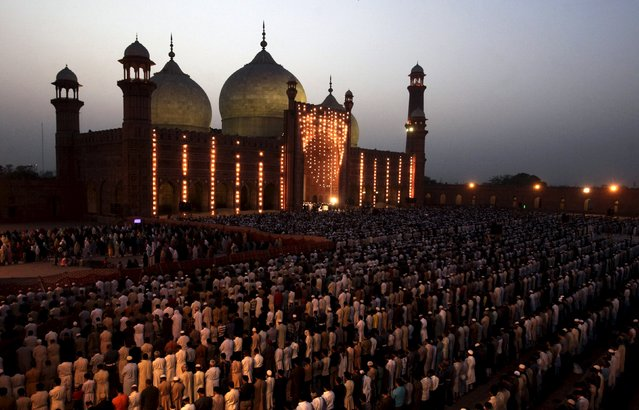 People say their prayers under the leadership of Saudi Arabian Imam of the Grand Mosque Sheikh Khalid al Ghamdi during evening prayers at the Badshahi mosque in Lahore, Pakistan, April 25, 2015. (Photo by Mohsin Raza/Reuters)