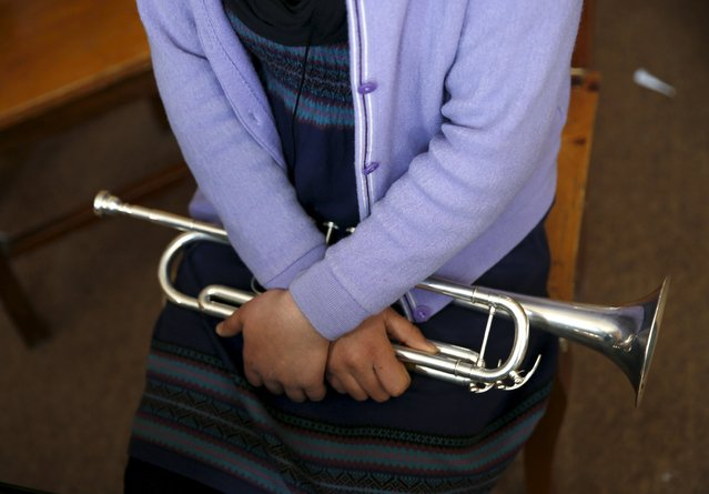 Mina Salarzai, a member of the Zohra orchestra, an ensemble of 35 women, holds her trumpet at Afghanistan's National Institute of Music, in Kabul, Afghanistan April 9, 2016. Playing instruments was banned under Taliban rule in Afghanistan, and even today, many conservative Muslims frown on most forms of music. Living in an orphanage in the capital, Kabul, 19-year-old Negin Ikhpolwak leads an ensemble of 35 women that plays both Western and Afghan musical instruments. In a country notorious internationally for harsh restrictions on women in most areas of life, Negin's story highlights a double challenge. (Photo by Ahmad Masood/Reuters)