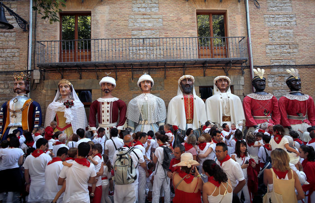 """Revellers take part in the """"Comparsa de gigantes y cabezudos"""" (Giants and Big Heads Parade) during the San Fermin festival in Pamplona, Spain, July 10, 2019. (Photo by Jon Nazca/Reuters)"""