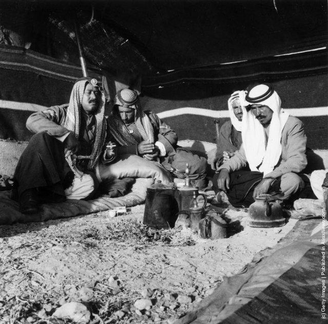 1955:  Bedouins (Arab., Badawi, 'dwellers in the desert'), nomadic Arabs in the Jordan Desert at camp. Virtually all Bedouins are Muslims