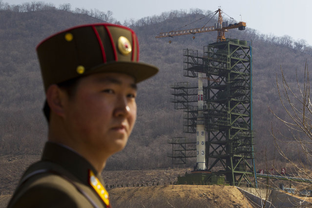 A North Korean soldier stands in front of the country's Unha-3 rocket, slated for liftoff between April 12-16, at a launching site in Tongchang-ri, North Korea on Sunday April 8, 2012. (Photo by David Guttenfelder/AP Photo)