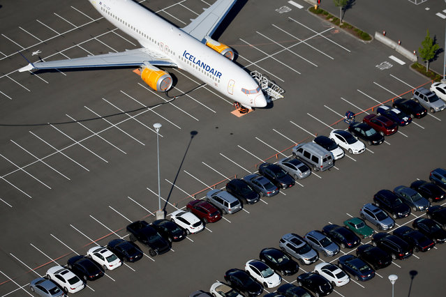 A grounded Icelandair Boeing 737 MAX aircraft is seen parked in a Boeing employee parking lot in an aerial photo at Boeing Field in Seattle, Washington, U.S. July 1, 2019. (Photo by Lindsey Wasson/Reuters)