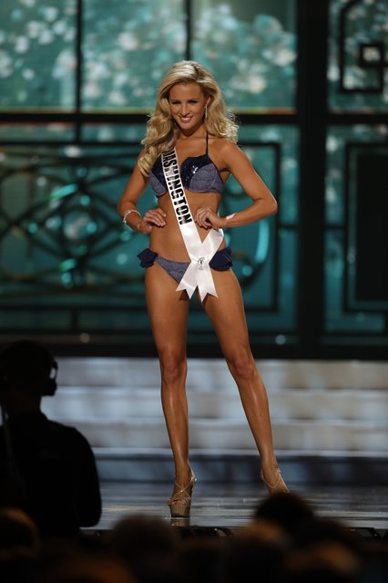 Miss Washington, Kenzi Novell, competes in the bathing suit competition during the preliminary round of the 2015 Miss USA Pageant in Baton Rouge, La., Wednesday, July 8, 2015. (Photo by Gerald Herbert/AP Photo)