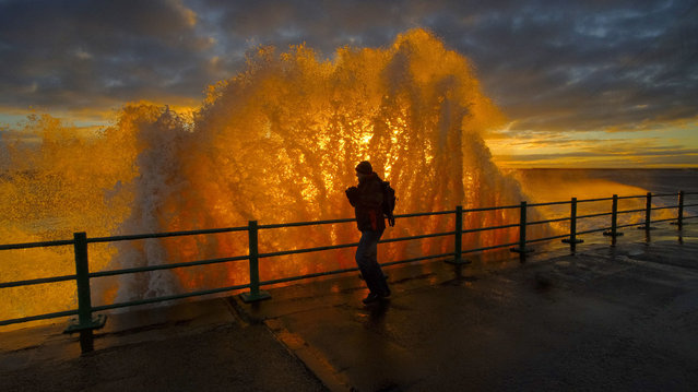 """Sunrise Through The Wave"", by John Alderson, which has won the People category. (Photo by John Alderson/PA Wire Press Association)"