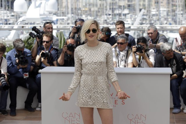 Actress Kristen Stewart poses for photographers during a photo call for the film Personal Shopper at the 69th international film festival, Cannes, southern France, Tuesday, May 17, 2016. (Photo by Lionel Cironneau/AP Photo)