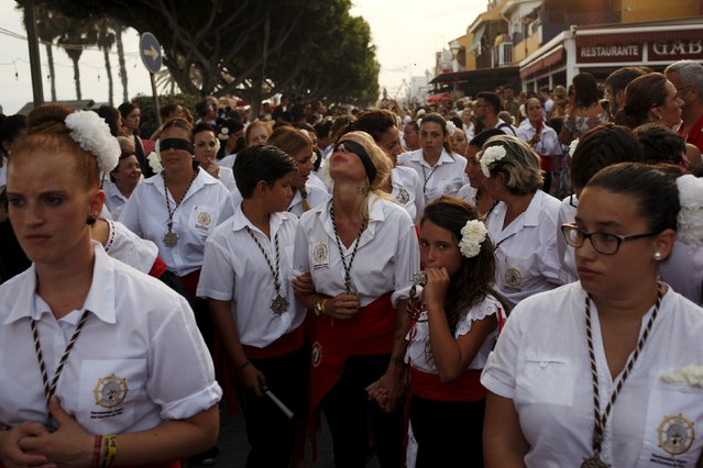 People in traditional costumes take part in the procession of the El Carmen Virgin being carried into the sea in Malaga July 16, 2015. (Photo by Jon Nazca/Reuters)