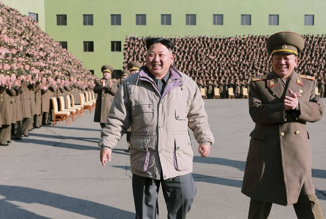 North Korean leader Kim Jong Un has a photo session with participants in the second meeting of KPA logistic personnel in this undated photo released by North Korea's Korean Central News Agency (KCNA) in Pyongyang December 25, 2014. (Photo by Reuters/KCNA)