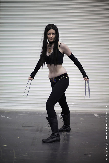 A visitor to the London Super Comic Convention dresses as X-23 at ExCel