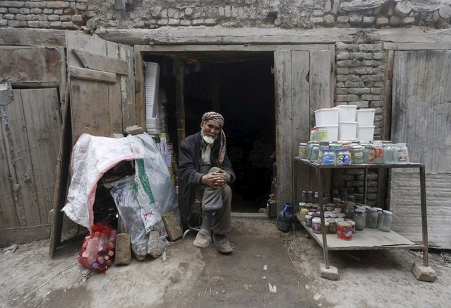 An Afghan man selling empty cans waits for customer at his shop in Kabul April 26, 2015. (Photo by Omar Sobhani/Reuters)