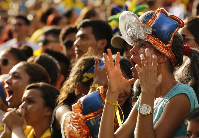 A Brazilian fan reacts as she watches her team play against Croatia during their 2014 World Cup opening match at a FIFA event in Manaus June 12, 2014. (Photo by Siphiwe Sibeko/Reuters)