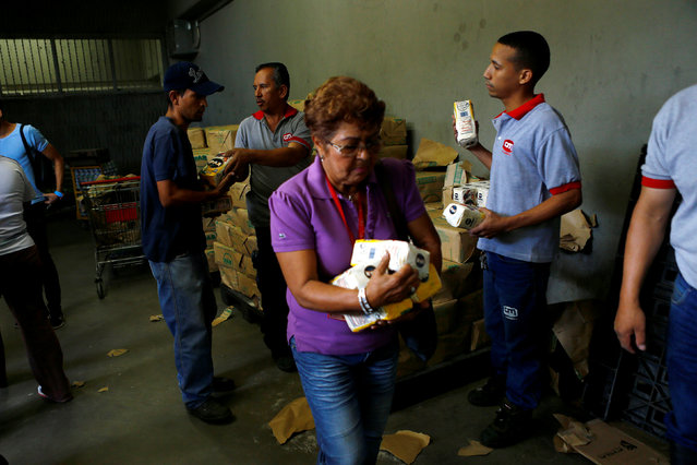People buy flour inside a supermarket in Caracas, Venezuela, June 10, 2016. (Photo by Ivan Alvarado/Reuters)