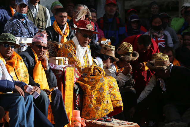 Jigme Palbar Bista, the former King of Lo, watches monks perform ceremonial dances during the Tenchi Festival on May 26, 2014 in Lo Manthang, Nepal. The Tenchi Festival takes place annually in Lo Manthang, the capital of Upper Mustang and the former Tibetan Kingdom of Lo. Each spring, monks perform ceremonies, rites, and dances during the Tenchi Festival to dispel evils and demons from the former kingdom. (Photo by Taylor Weidman/Getty Images)
